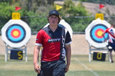 Olympic hopeful Jack Williams steadies his hands for a precise shot at the archery range, hoping to advance his archery career.