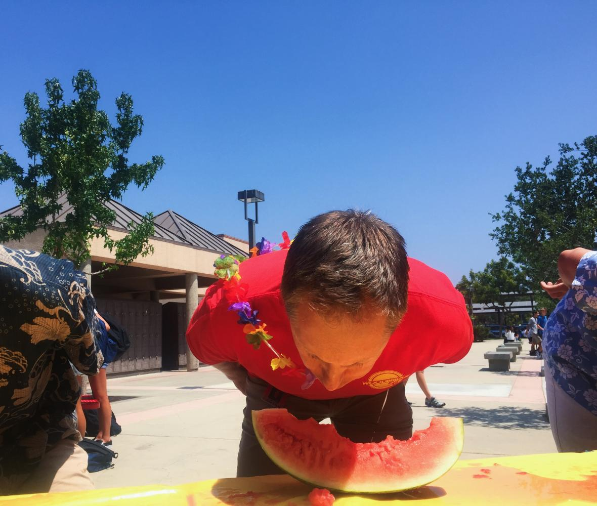 Assistant principal, Scott Sodorff, participates in a watermelon-eating contest during lunch.