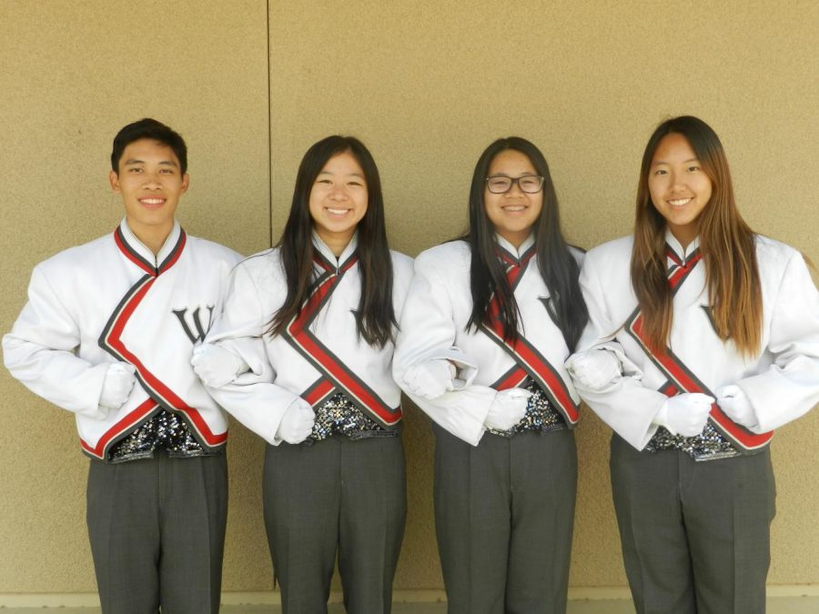 Senior+drum+majors+%28left+to+right%29+Malcolm+Tsay%2C+Jody+Lin%2C+Sabrina+Wang%2C+and+Margaret+Lee+pose+in++in+their+distinct+drum+major+uniforms.