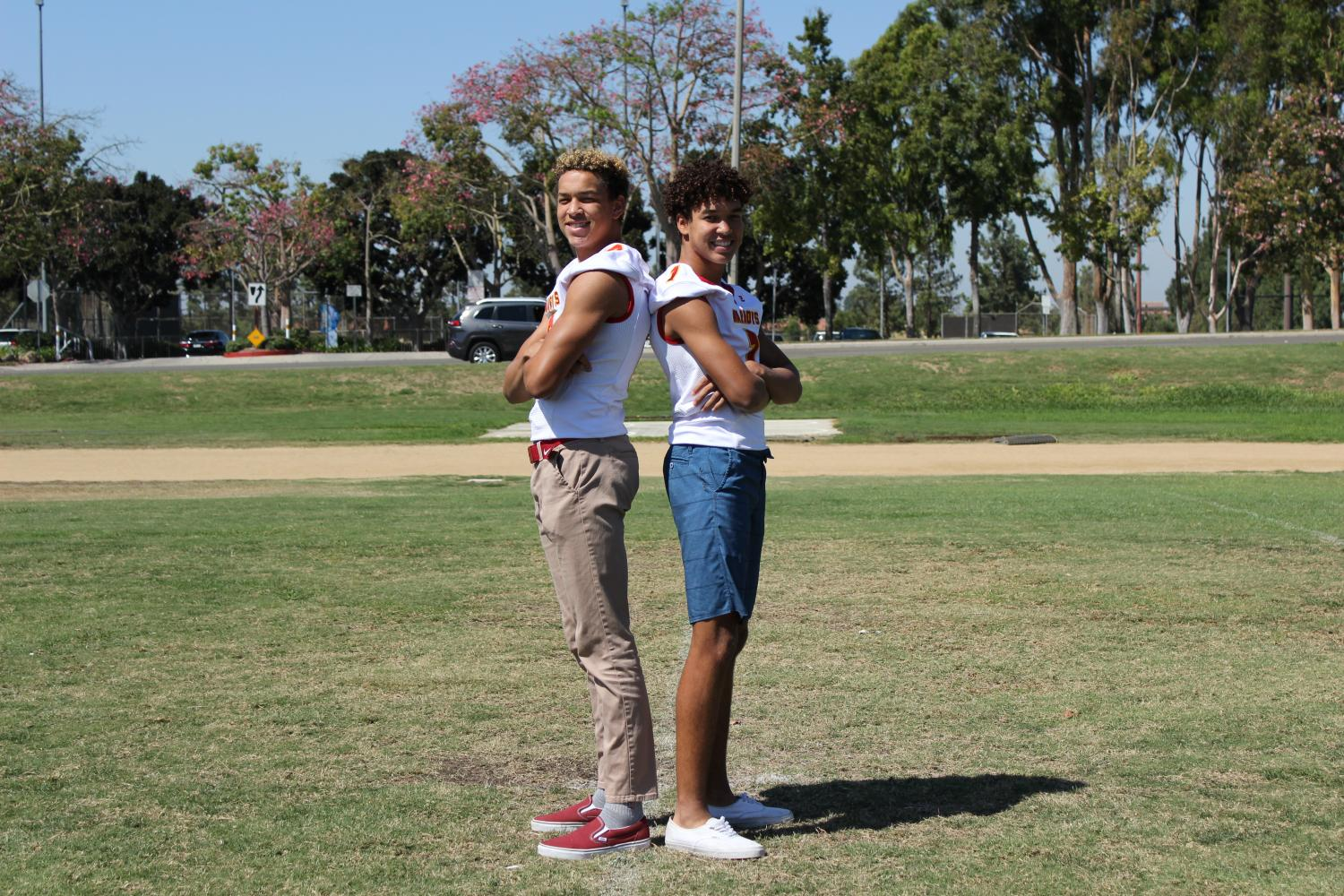 Brothers Nick and Jacob Nash pose back-to-back on the WHS football field in support of each other.
