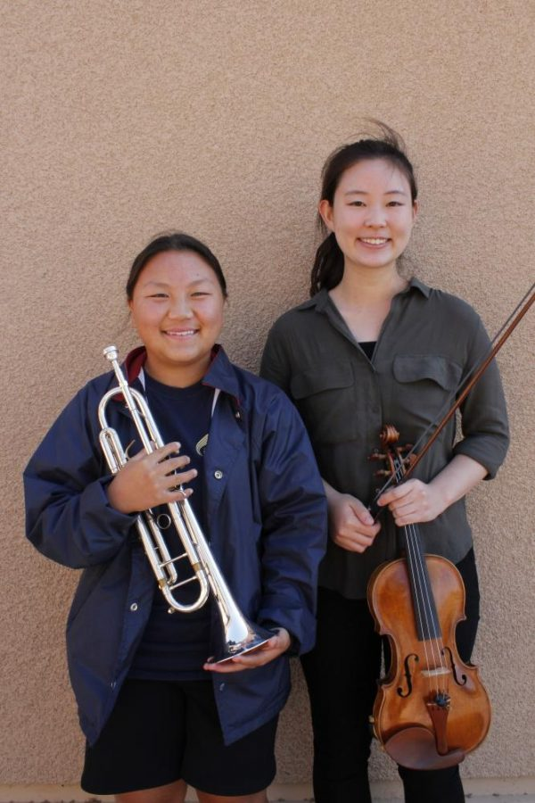 The student musicians pose with their instruments.