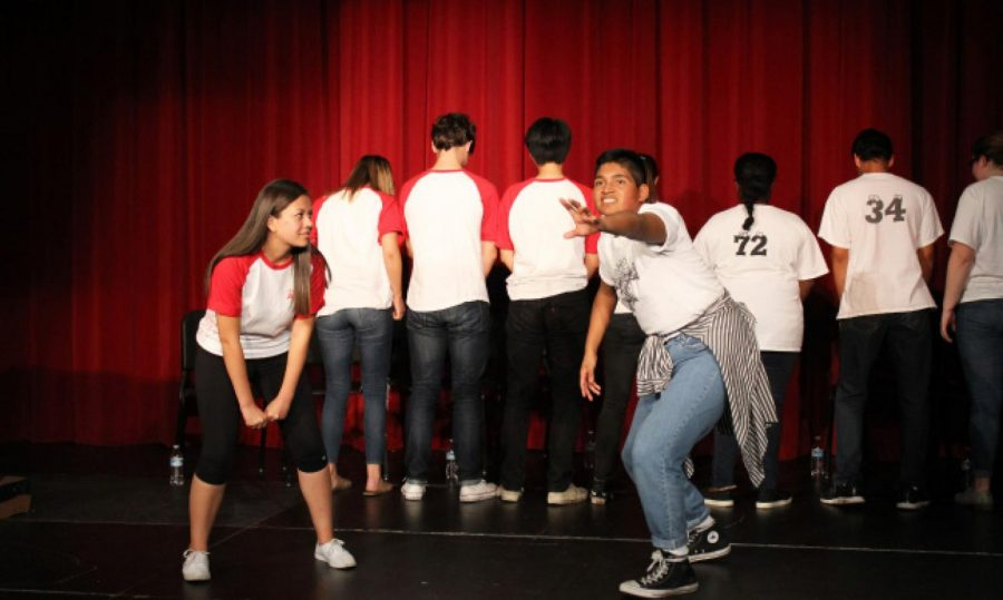 ImprovCity High members compete in a game on stage.