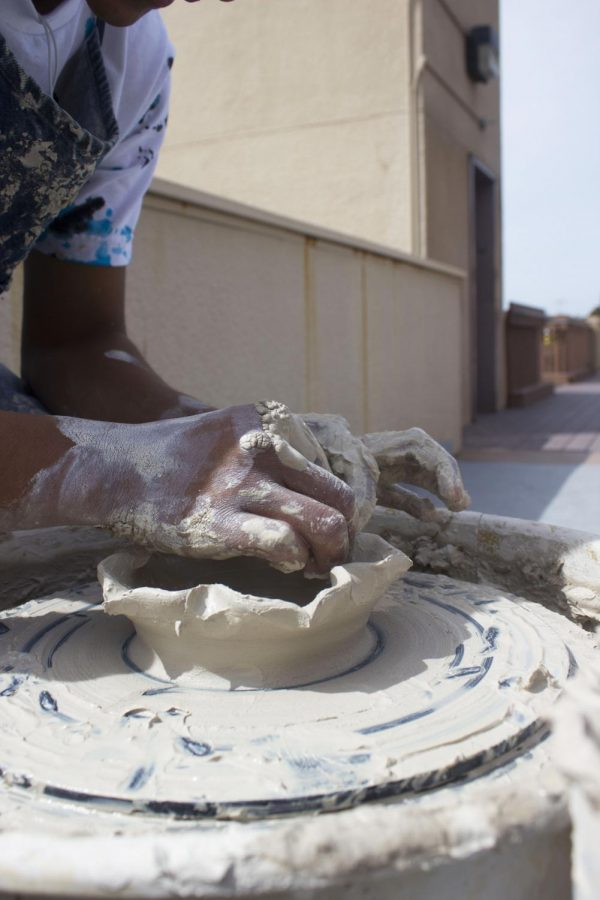 Ceramics students showcase their molding skills on demand for students to witness.