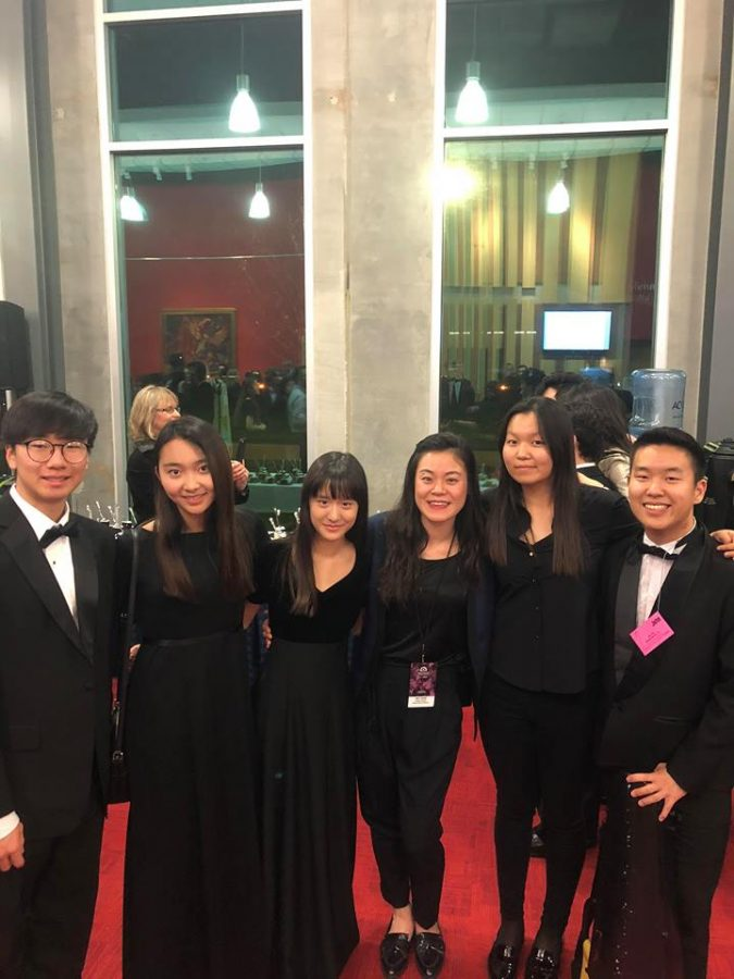 Students dress in formal black attire to unite through the National Orchestra performance.