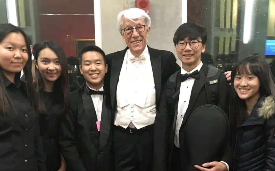 Students triumphantly pose after finishing the National Orchestra concert.