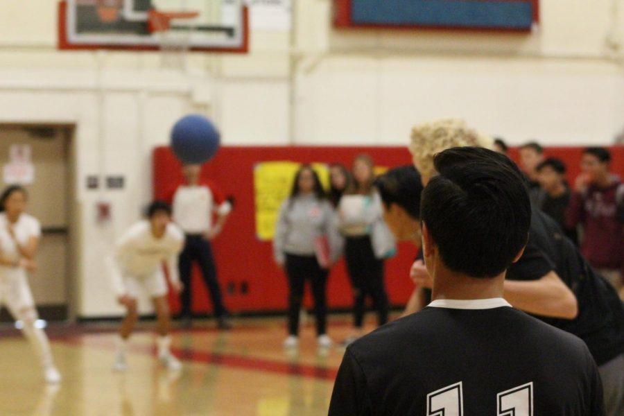 Junior Ryan Quintos partakes in the dodgeball tournament during April.