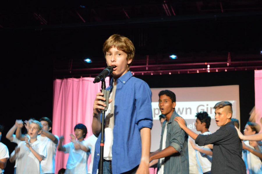 Choir+students+groove+to+%22Uptown+Girl%22+in+the+all-male+song+interpretation.+