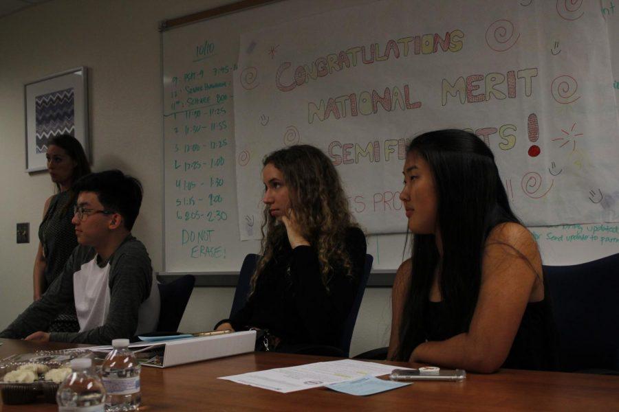 Seniors Ben Chang, Natalie Imshev and Emily Yu listen intently.