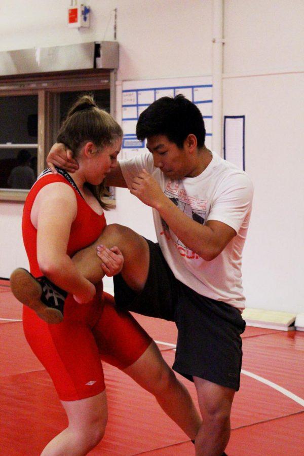 Sophomore Rebecca Kinder shows her wrestling skills during wrestling practice after school.