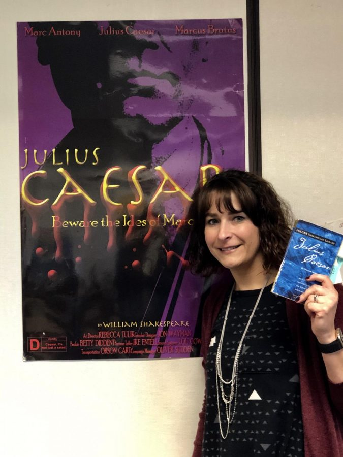 Christine Haley poses with a copy and poster of