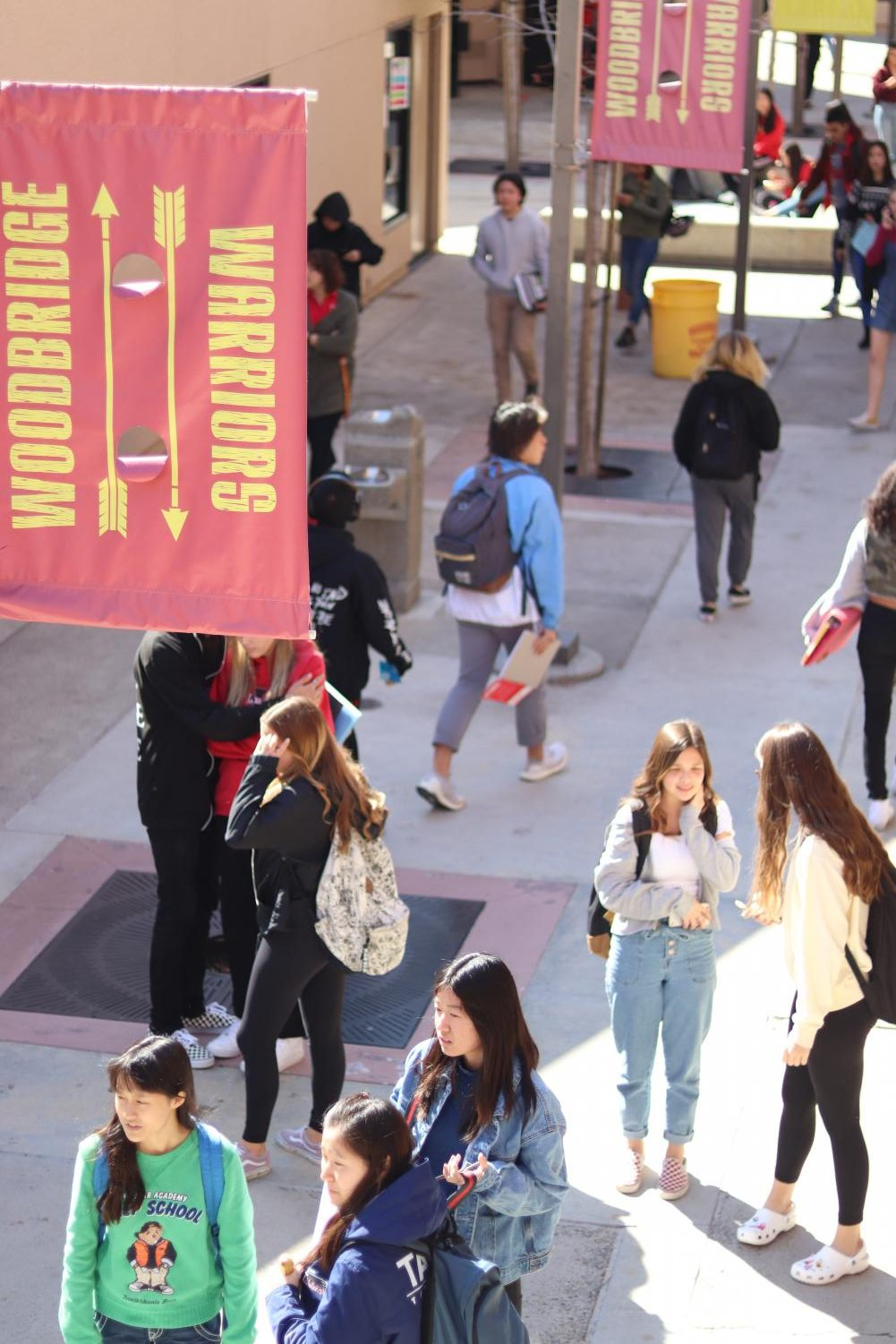Students walk during the passing period to their fourth period classes.