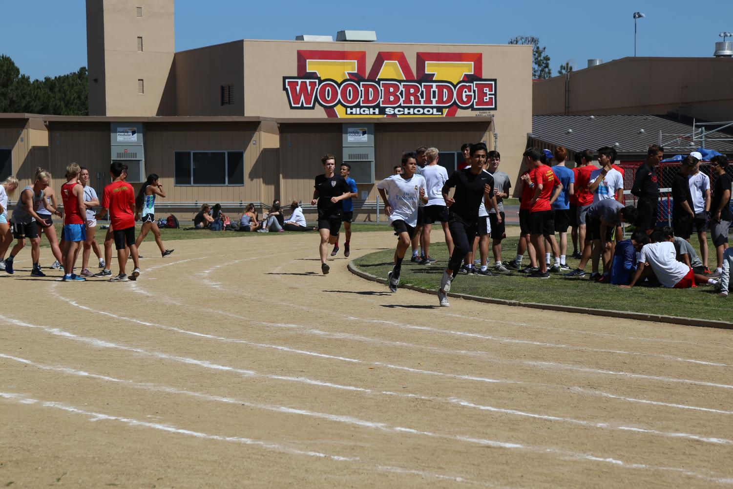 Track athletes practice on the current track.