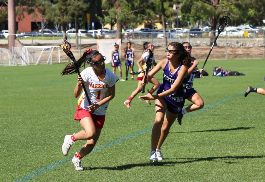 Junior Taylor Le charges towards her opponents during a game against Northwood.