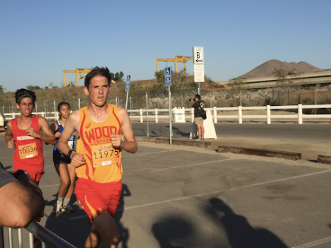 Junior Carter Allan runs in the JV Gold Division Race.