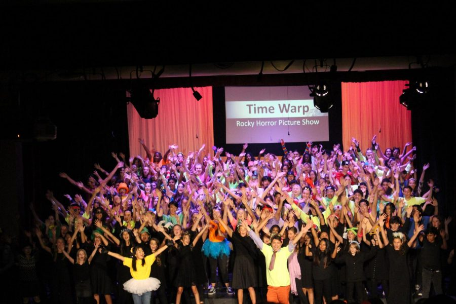 Students passionately sing in unison during the Songs and Stories performance that took place October 22-October 24.