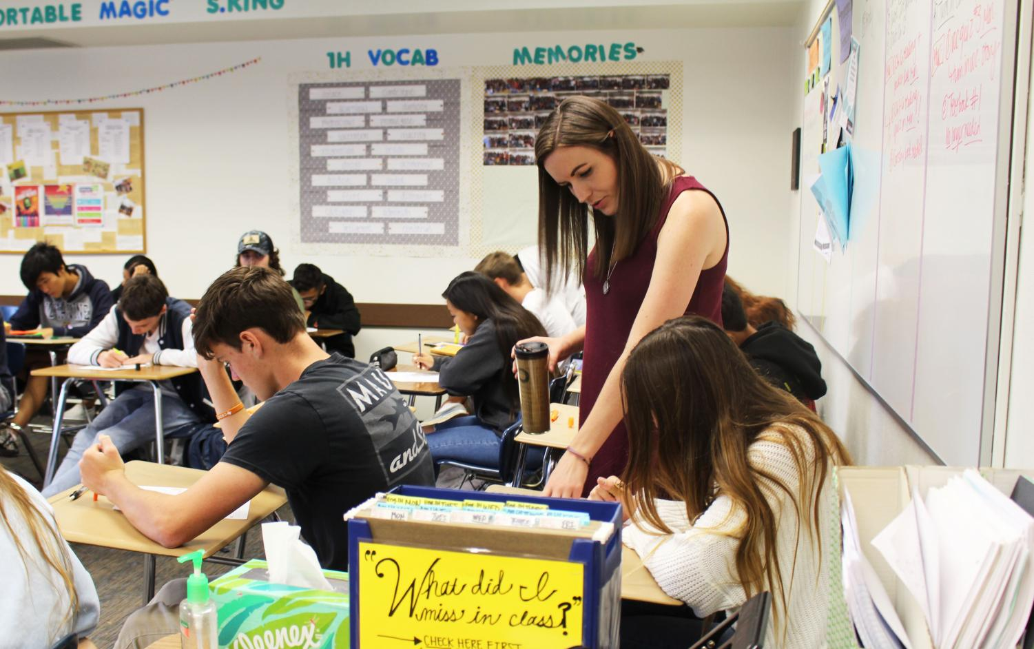 English teacher Jennifer Schmidt  helps her American Literature students with a new lesson.