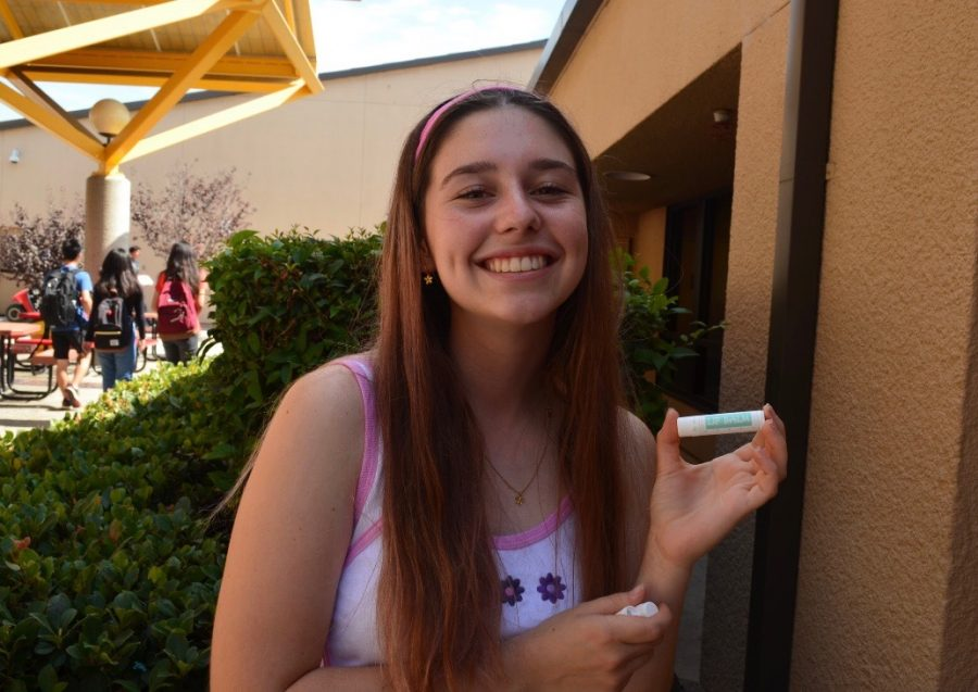 Junior Amelie Gerber shows off her quality lip balm she is planning on selling.