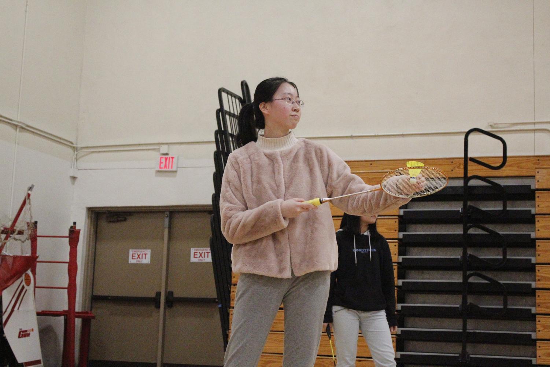 Junior Julia Yuan prepares to serve.