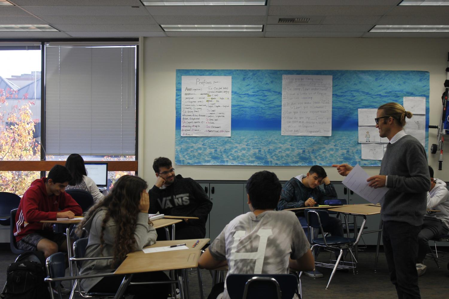 ELD teacher Dan Kozak gives instructions to his students during class.