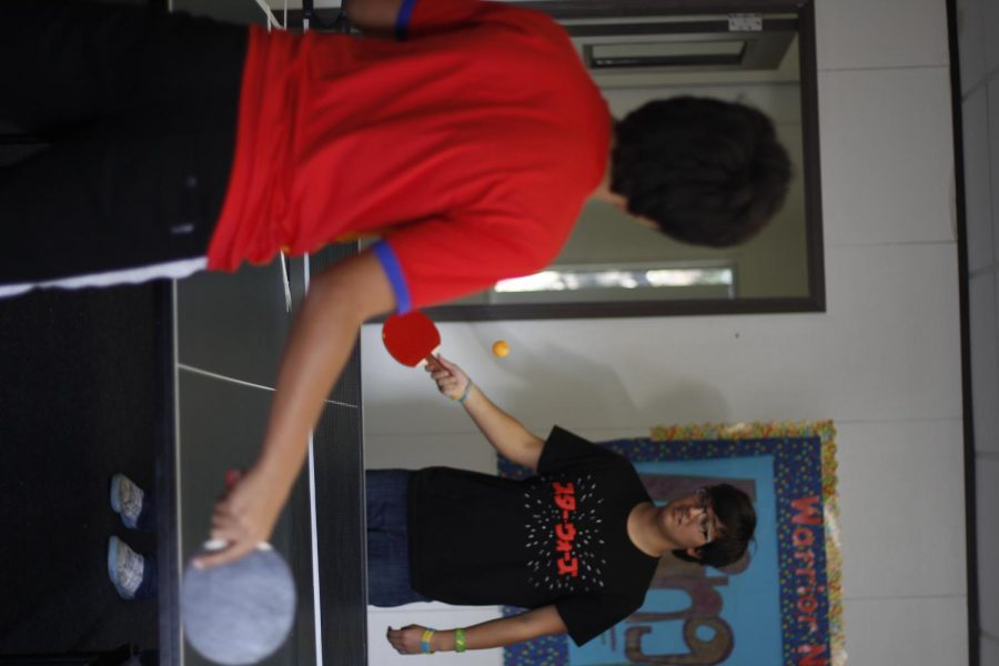 Sophomore Noah Marin and freshman Sina Shahabeddin participate in a ping pong match.