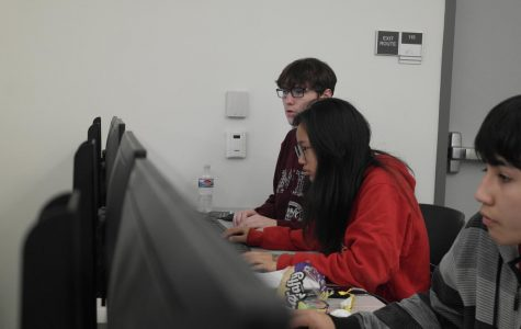 Sophomores Charlene Hui and Seth Ferrell compete at a cybersecurity competition.
