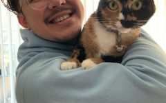 Science teacher Will Buckley with his cat Autumn, just one of many pets teachers own.