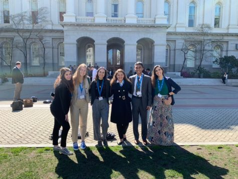Woodbridge High advocates pose in front of the state capitol before they enter to advocate for policy changes.