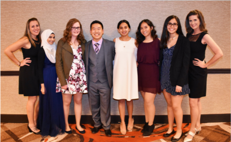 Senior John Cho (fourth from left) poses with his speech and debate team.