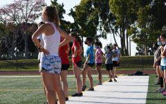Runners prepraing for their distance run.