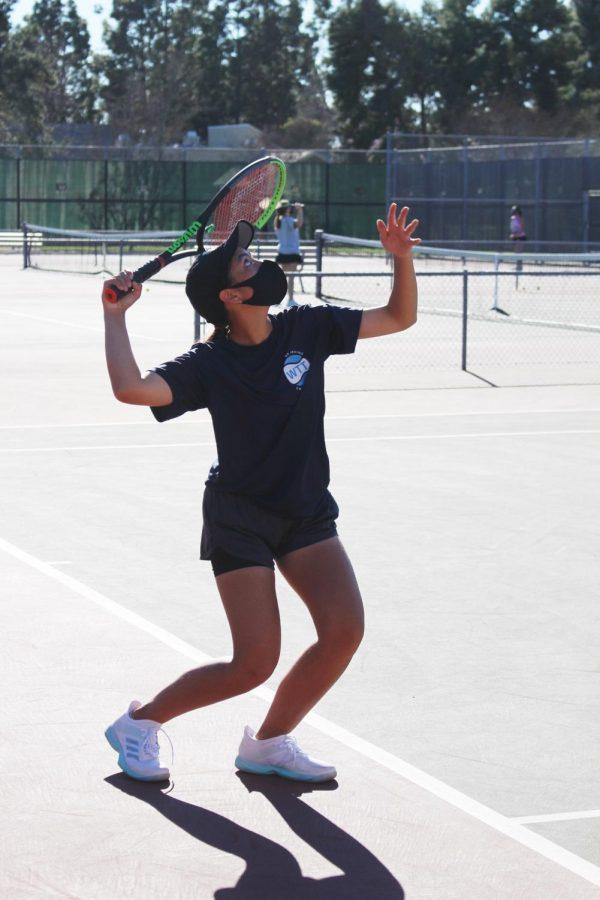 Girls varsity tennis practice serves to prepare for their long awaited season